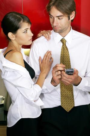 Woman seducing man in the kitchen  photo