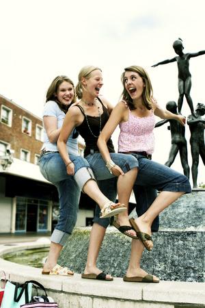 chuckling: Three girls having fun