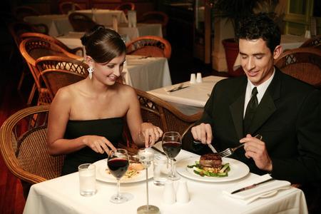 cherishing: A couple having dinner in a restaurant