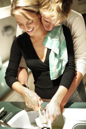 highlighted hair: A couple washing dishes together