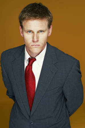A serious looking man in business suit
