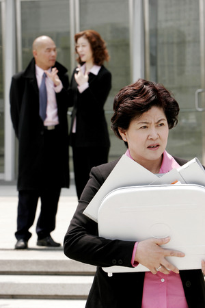 industrious: An angry woman carrying a briefcase of documents