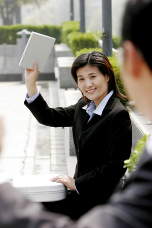 aspirant: Woman showing her manager the completed work