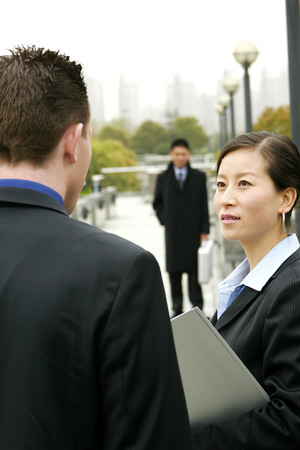 desirous: A woman talking to his superior  Stock Photo