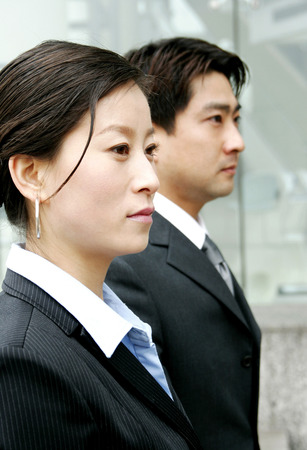 desirous: Side shot of a woman and a man in office attire Stock Photo