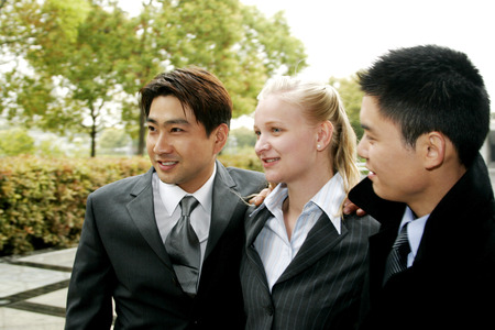 desirous: Three business people standing together Stock Photo