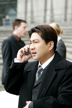 desirous: A man in business suit talking on the hand phone