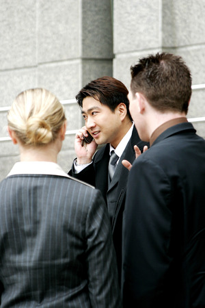 A man busy talking on the hand phone