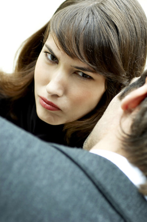 Woman sulking in front of a man