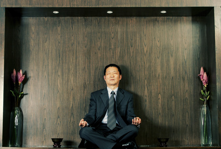 philosophical: A man in business suit meditating