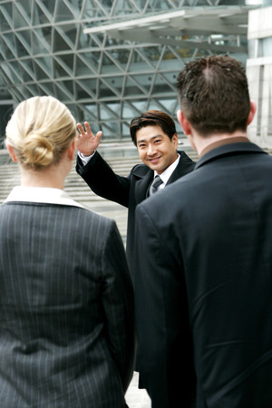 A man waving goodbye to his friends  photo