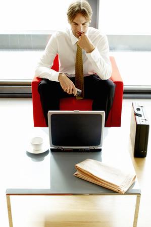 Businessman using a laptop  photo