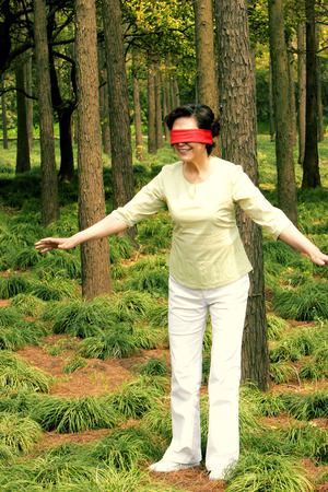 A blindfolded woman trying to find her way