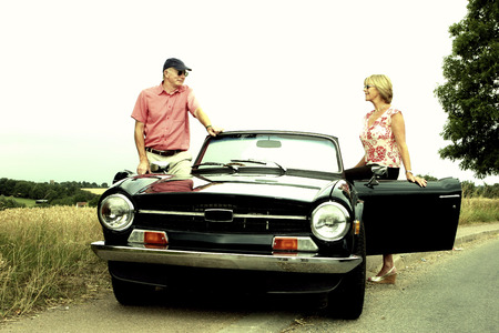 roofless: A man and a woman getting into the car