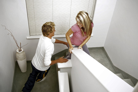 Man chasing his girlfriend on the stairs photo
