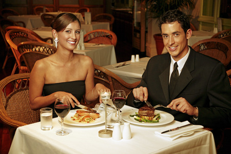 A couple having dinner in a restaurant photo