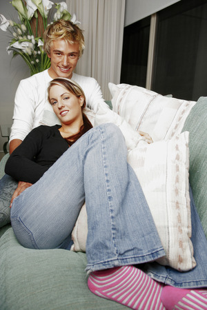 cherishing: A couple sitting on the couch