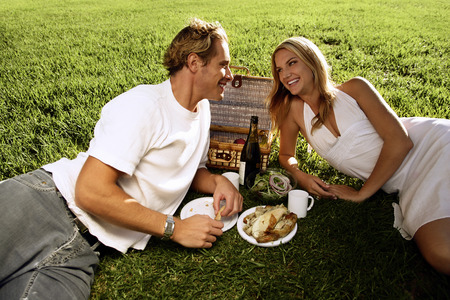 cherishing: A couple picnicking in the park Stock Photo