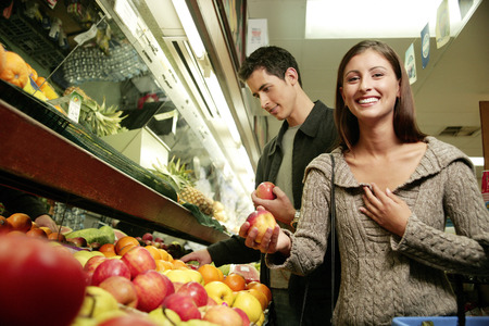 compatible: A couple shopping for fruits