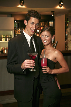 cherishing: A couple posing with their drinks in the bar