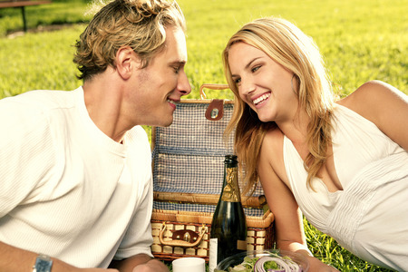 A couple picnicking in the park Stock Photo