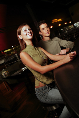 cherishing: A couple hanging out in a bar
