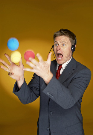aspirant: Man trying to juggle with three balls  Stock Photo