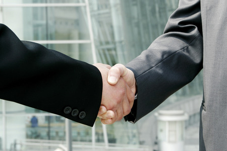 desirous: A handshake between two businessmen  Stock Photo