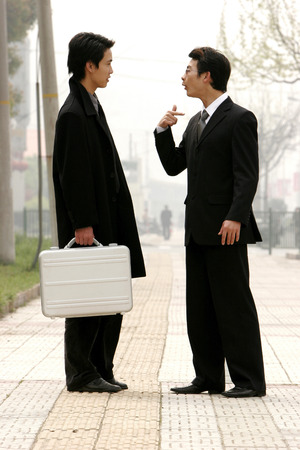 bespectacled man: A bespectacled man scolding his colleague