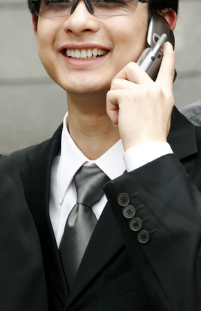 aspirant: Close-up of a man with sunglass talking on the hand phone