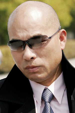 aspirant: Bald man in business suit looking smart with sunglass  Stock Photo