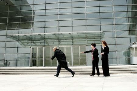 snatch: Bald man snatching away a womans briefcase