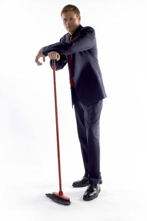 aspirant: Businessman holding a broom