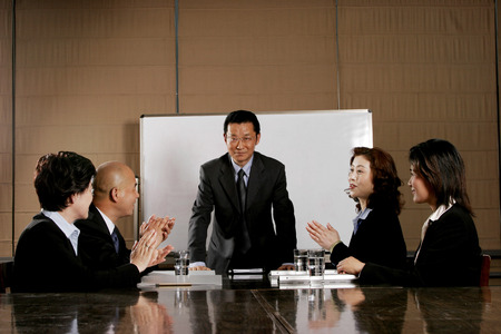 Business man and women clapping their hands after a good presentation  photo