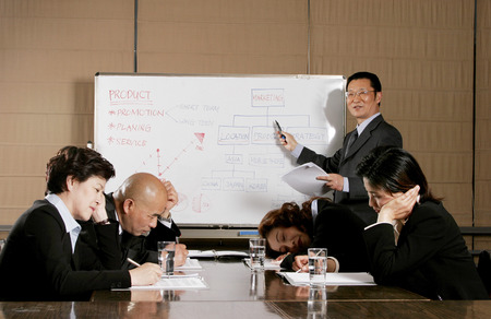 sleep well: Man and women falling asleep after listening to a dull presentation by the manager Stock Photo
