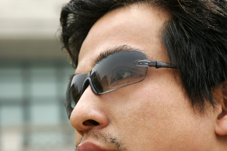 Close-up picture of a man wearing sunglass  photo