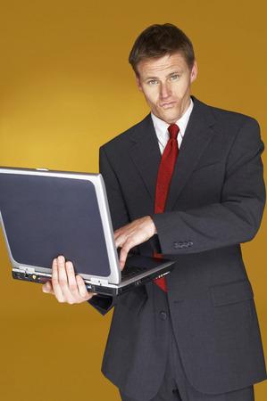 aspirant: Businessman using a laptop