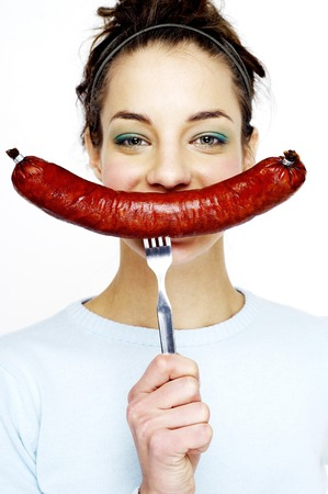 Woman showing a long sausage