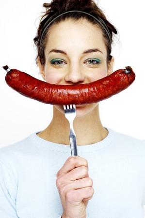 Woman showing a long sausage