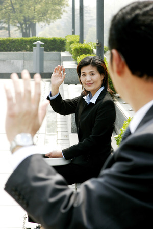 desirous: Woman waving to her manager