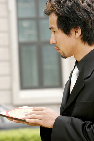 aspirant: Businessman using a Luopan compass to check the feng shui  Stock Photo