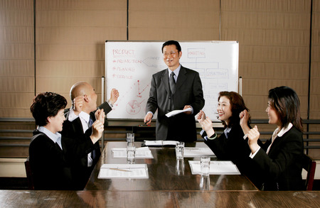 aspirant: Business man and women rejoicing their success