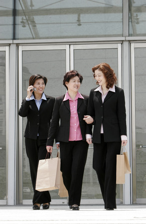 Three business women walking together