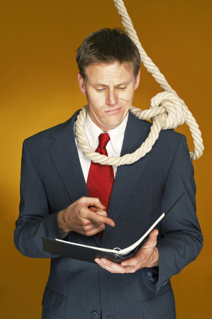 aspirant: Businessman reading a document with a rope hanging around his neck