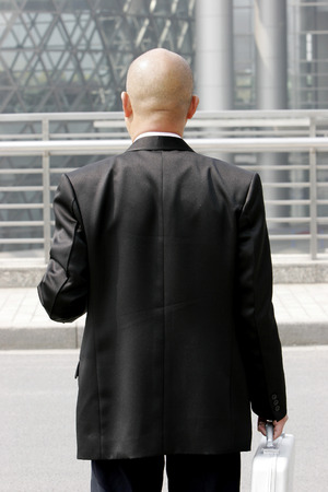 desirous: Back shot of a bald man in business suit  Stock Photo