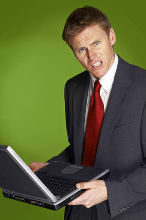aspirant: Businessman holding a laptop  Stock Photo
