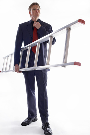 aspirant: Man in business suit holding a ladder