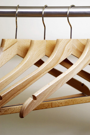 Clothes hangers hanging in a wardrobe  photo
