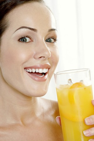 flavoursome: Woman holding a glass of orange juice