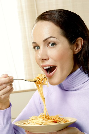 Woman having a bowl of spaghetti photo